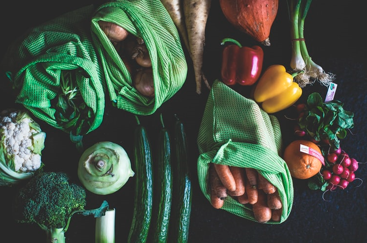 A group of vegetables in green mesh bags